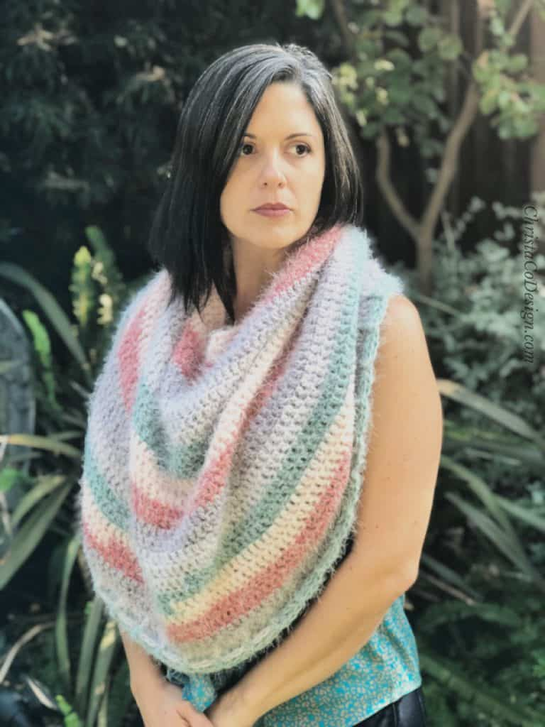 picture of woman in oversized crochet cowl from latte cake yarn blue white and pink stripes