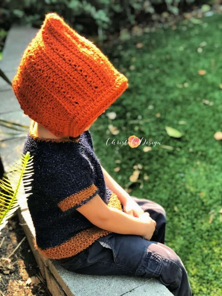 picture of boy in rust colored crochet pixie hat
