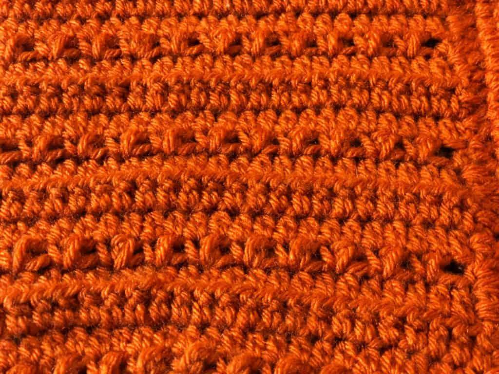 Close up of crochet pixie hat pattern texture.