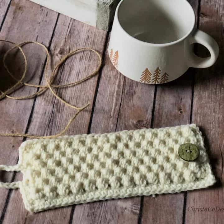 picture of crochet cup cozy white with mug and twine