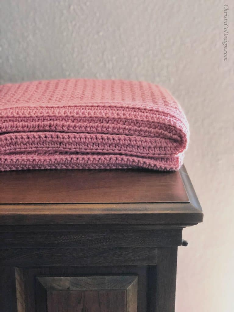 picture of folded pink baby blanket crochet pattern