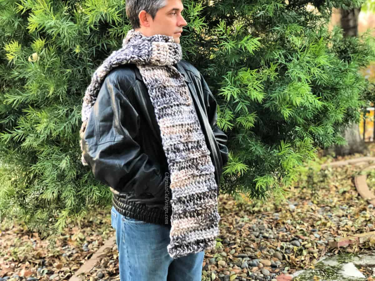 Man outside wrapped in super scarf from #7 jumbo yarn.