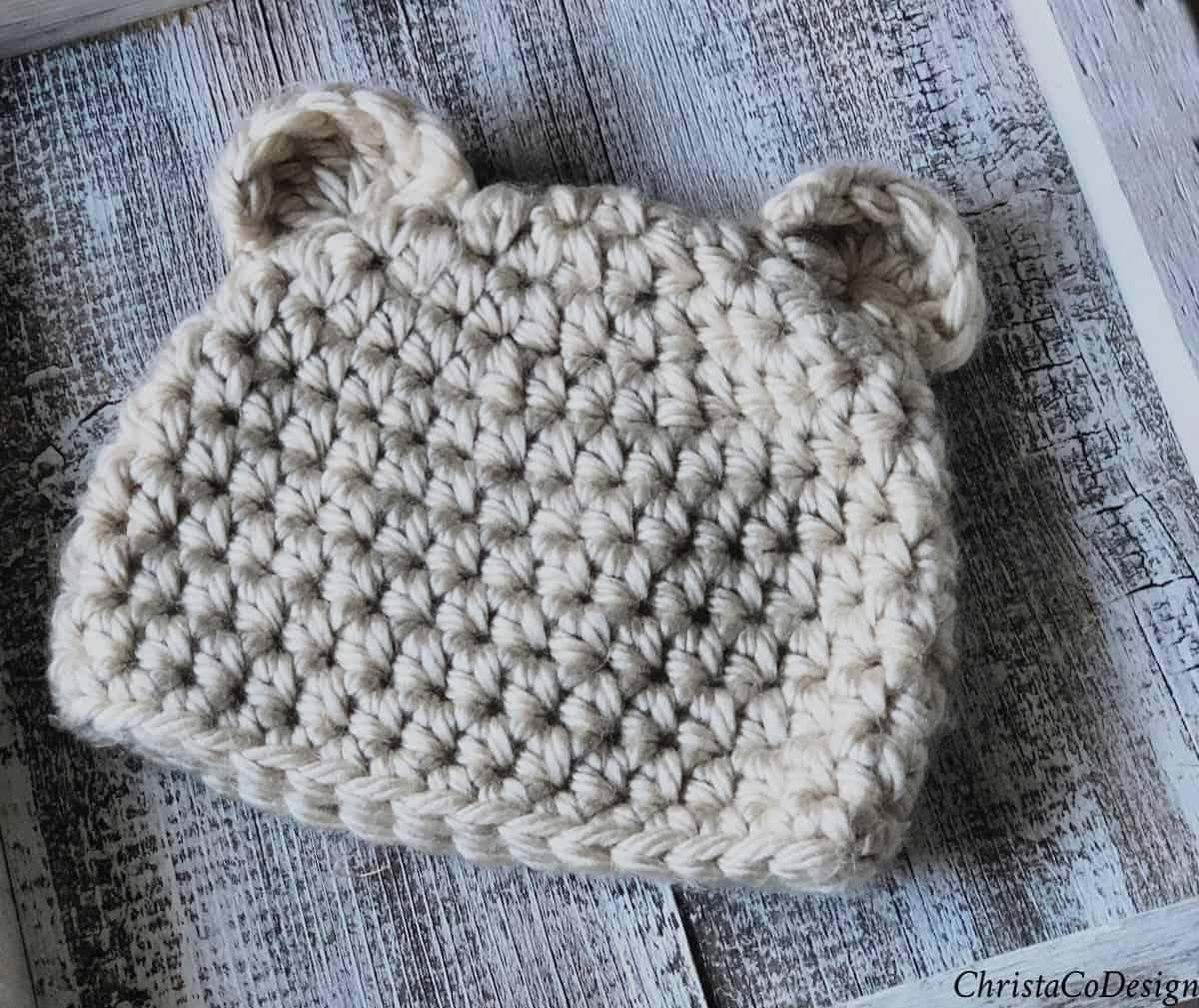 Cream colored crochet bear beanie with ears.