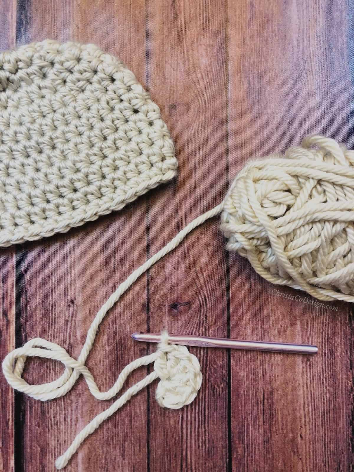 Cream colored crochet bear ear.
