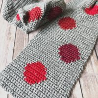 picture of grey scarf with red dots laid flat crochet pattern