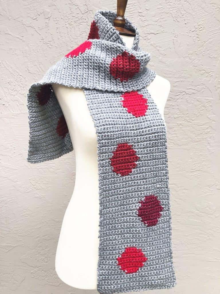 picture of grey scarf with red dots free crochet pattern on mannequin