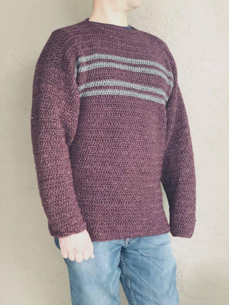 Man wearing striped crochet sweater burgundy grey stripes.
