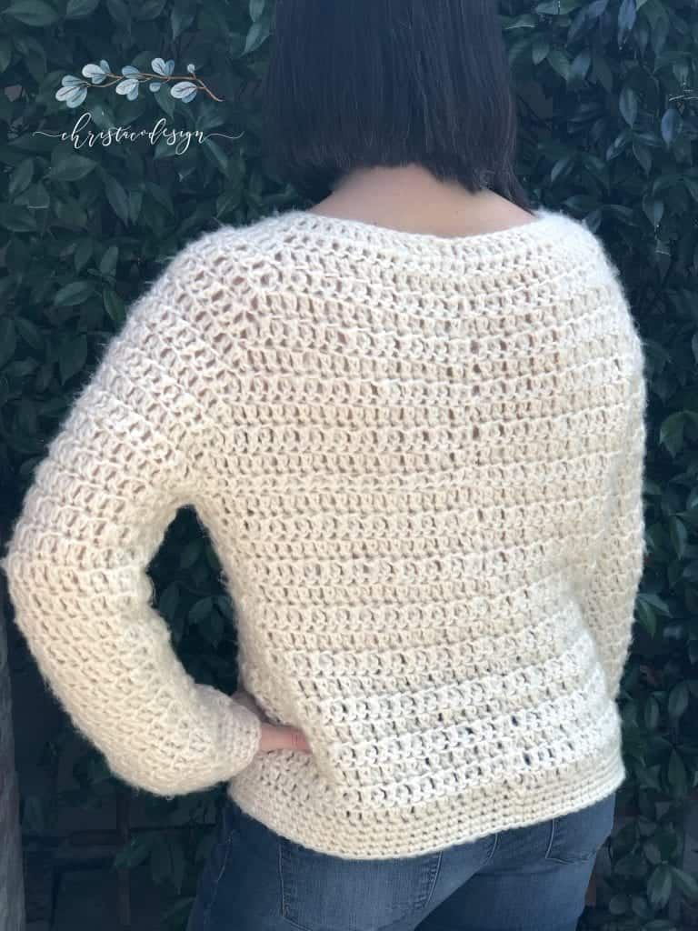 picture of back of woman in textured chunky crochet sweater