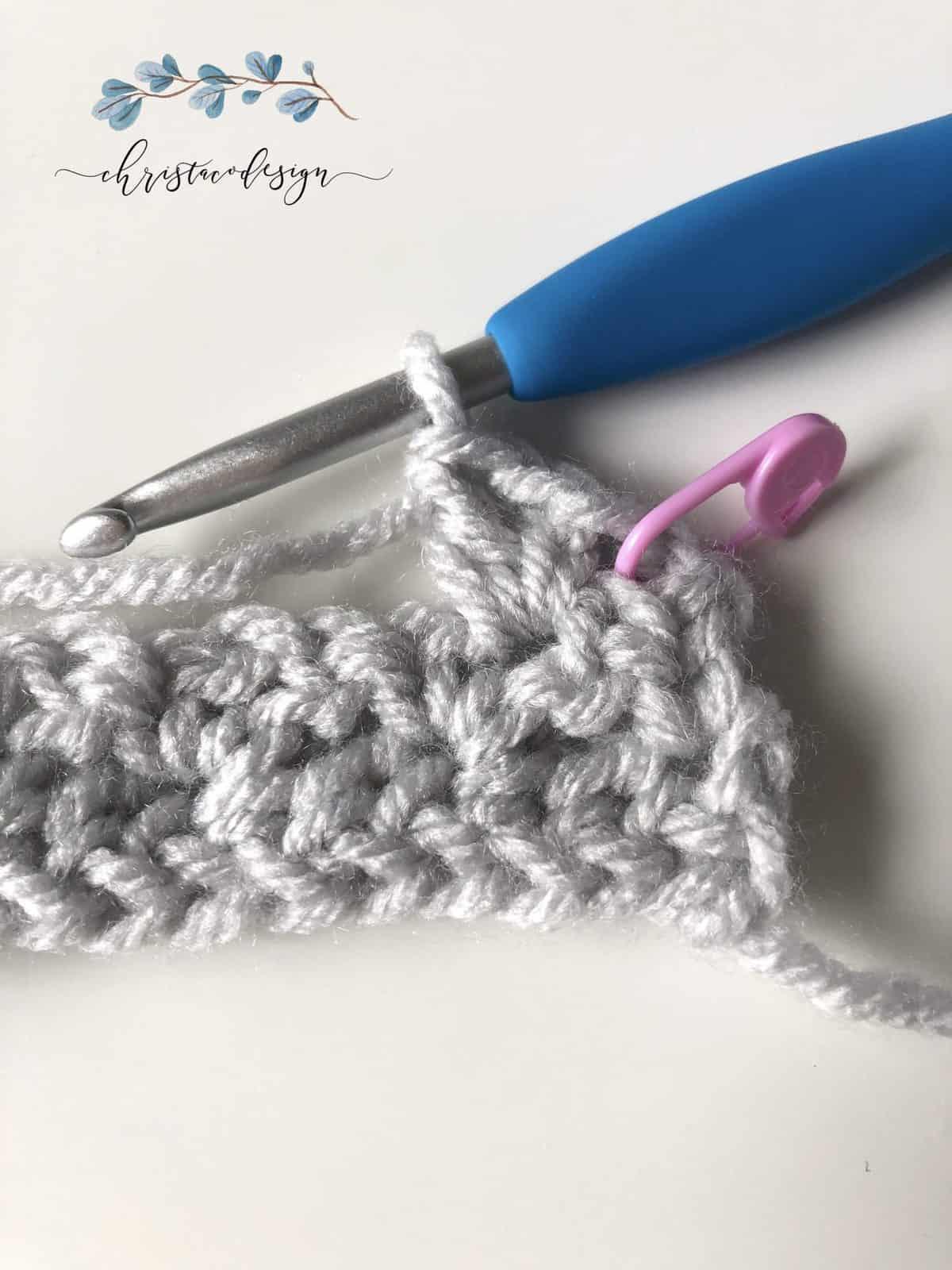 First wattle stitch of Row 3 tutorial.