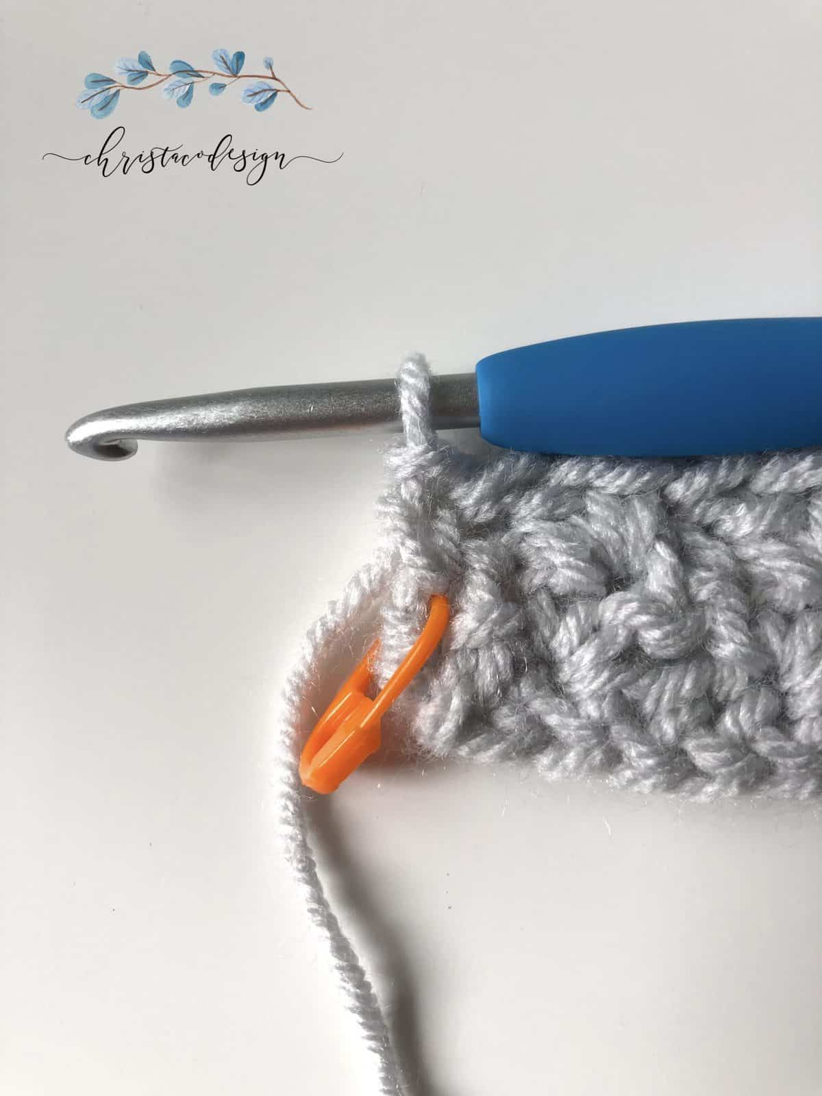 End of row 3 wattle stitch with orange marker.