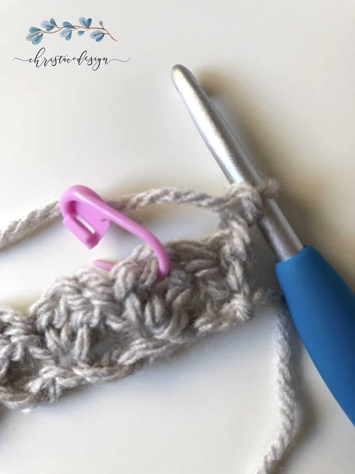 Pink stitch marker in row 2.
