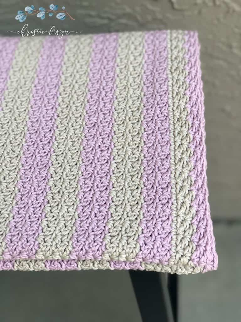 picture of pink and grey striped wattle stitch blanket folded