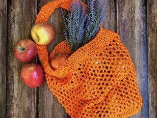 picture of crochet mesh market tote with apples flat lay