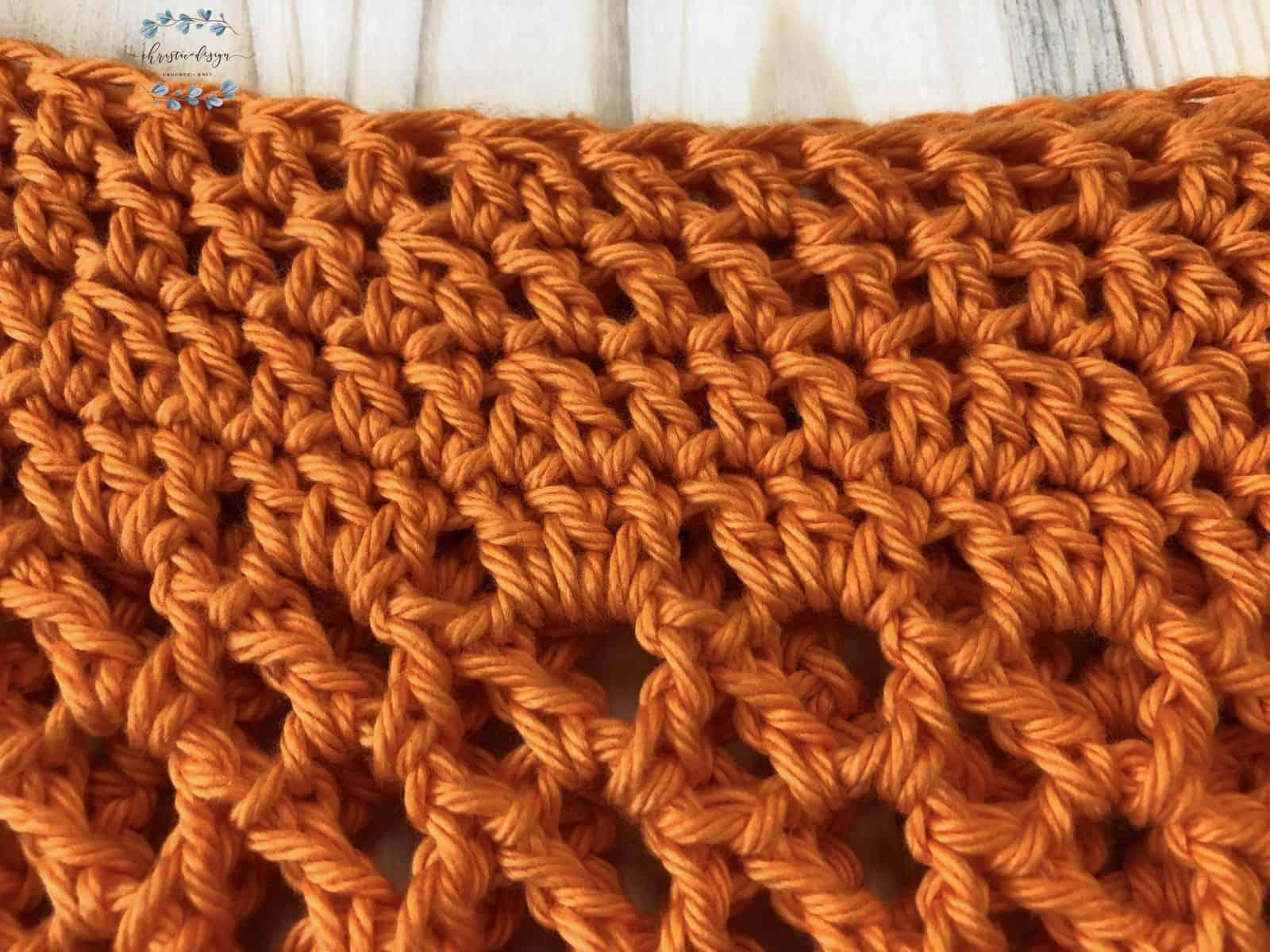 Crochet stitches on orange free crochet tote bag pattern.