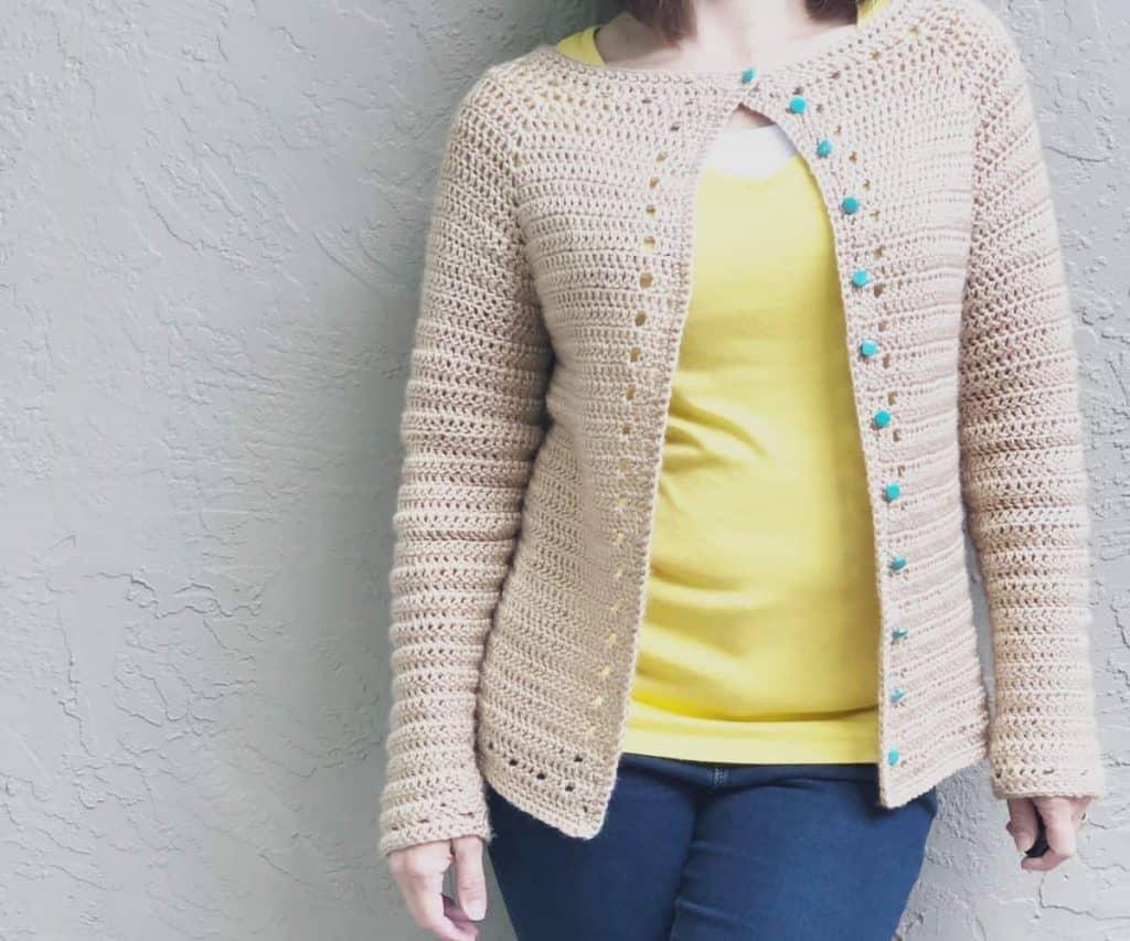Woman in yellow wearing the Spring Crochet Cardigan.