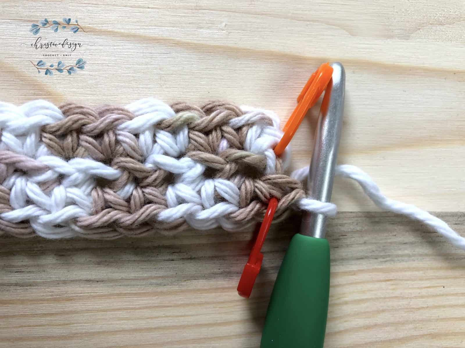 Start row 3 with 2 single crochets and mark the second.