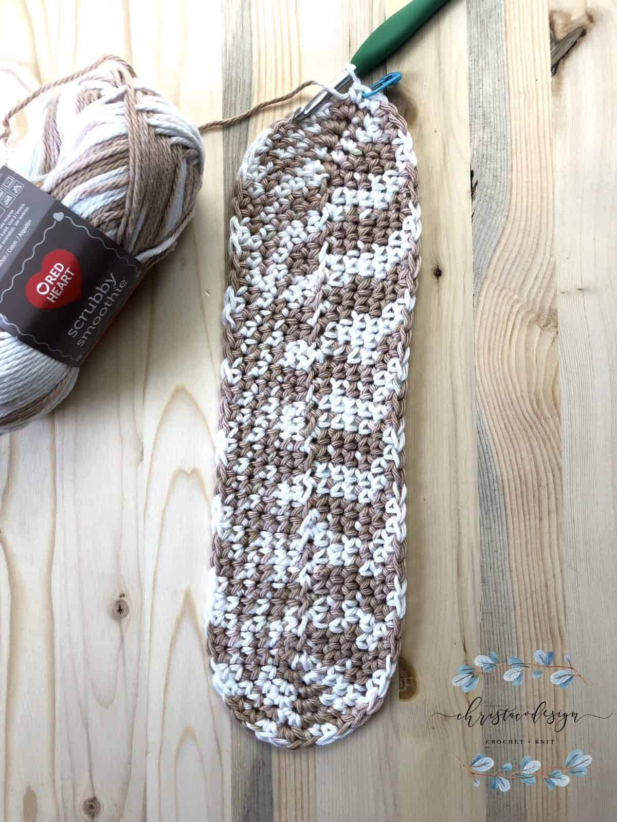 Bottom of free crochet tote bag pattern complete in variegated cotton smoothie yarn.