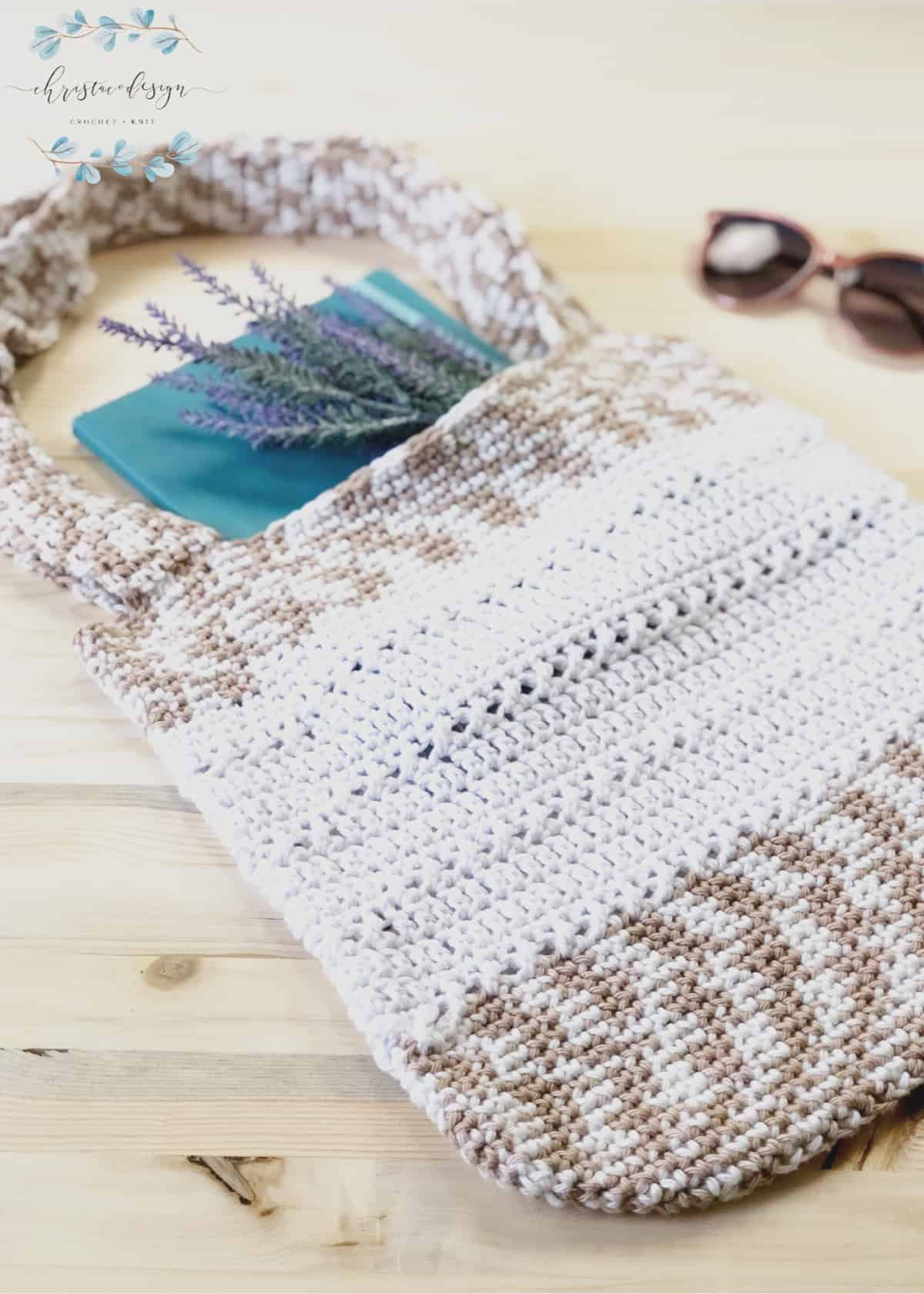 Free crochet tote bag pattern with lavender and teal book inside.