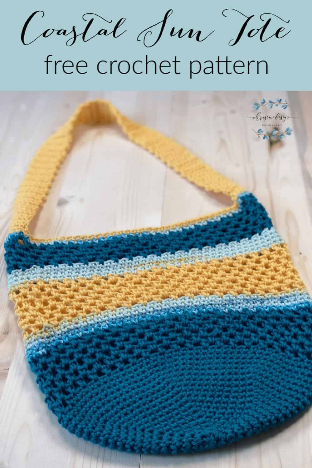 Pin image and text for free crochet tote bag in blue and yellow laid flat on wood table.
