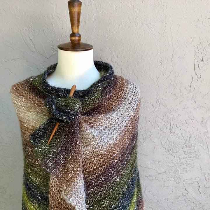 Lightweight knit wrap striped in earth tones.