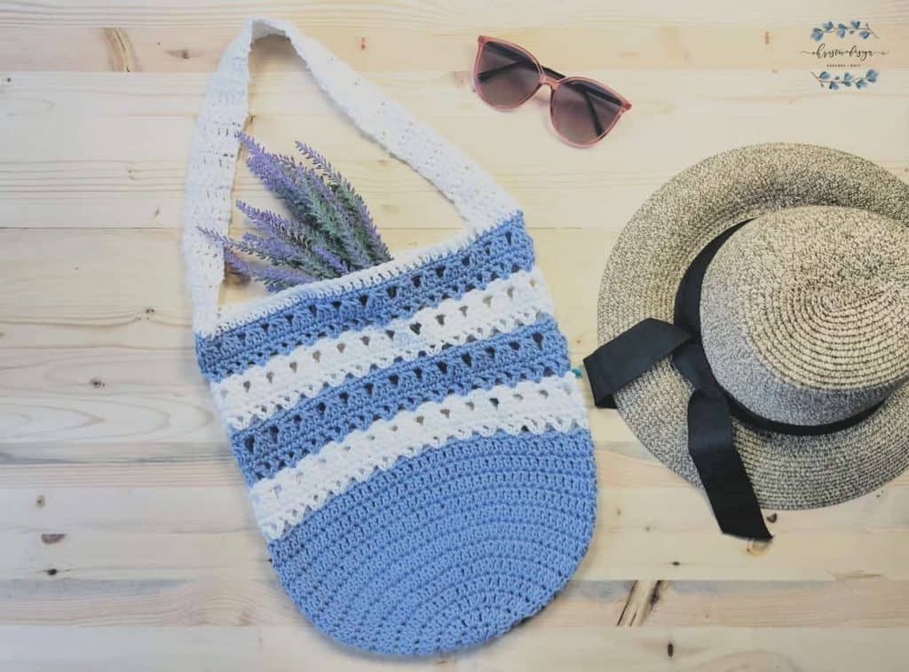 Free crochet market tote pattern in striped blue and white flat lay.