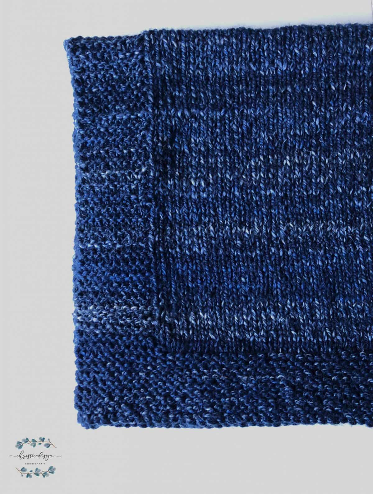 picture of blue knit blanket corner