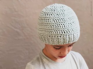 picture of light blue crochet beanie on boy