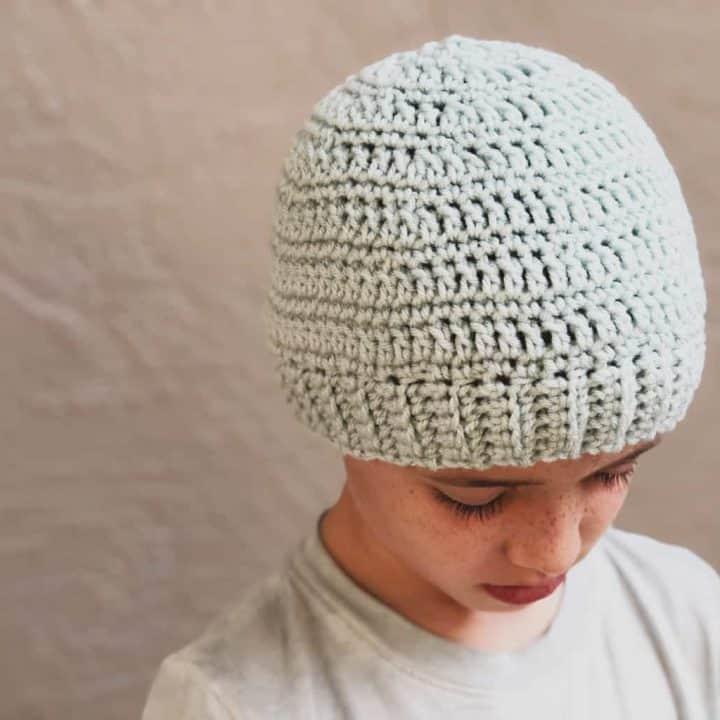 picture of light blue crochet beanie on boy