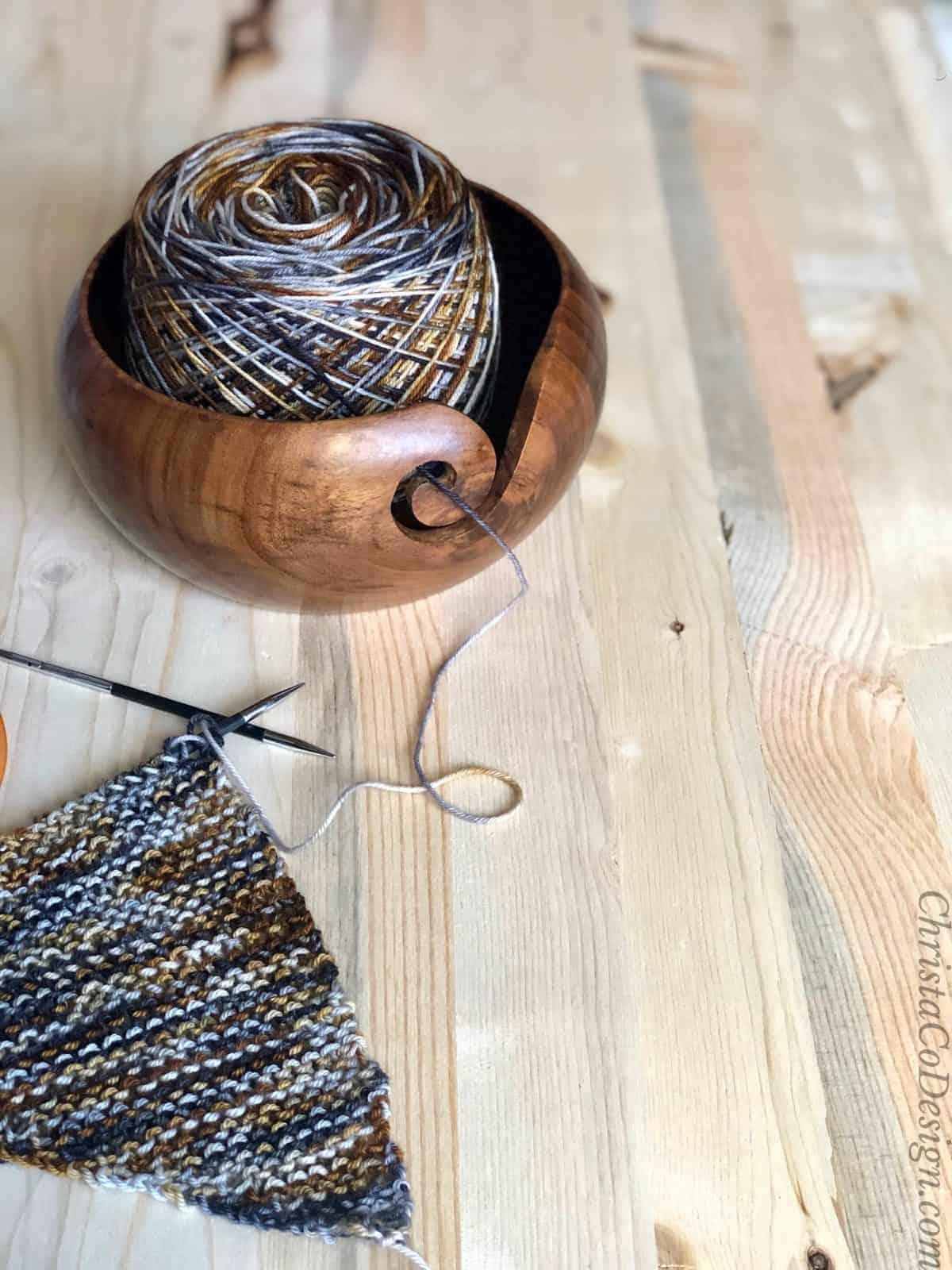 Beginning of knit triangle scarf on needles free beginner pattern.