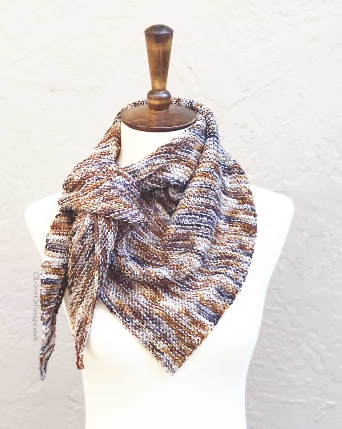Copper and brown knit triangle scarf easy beginner garter stitch on mannequin.