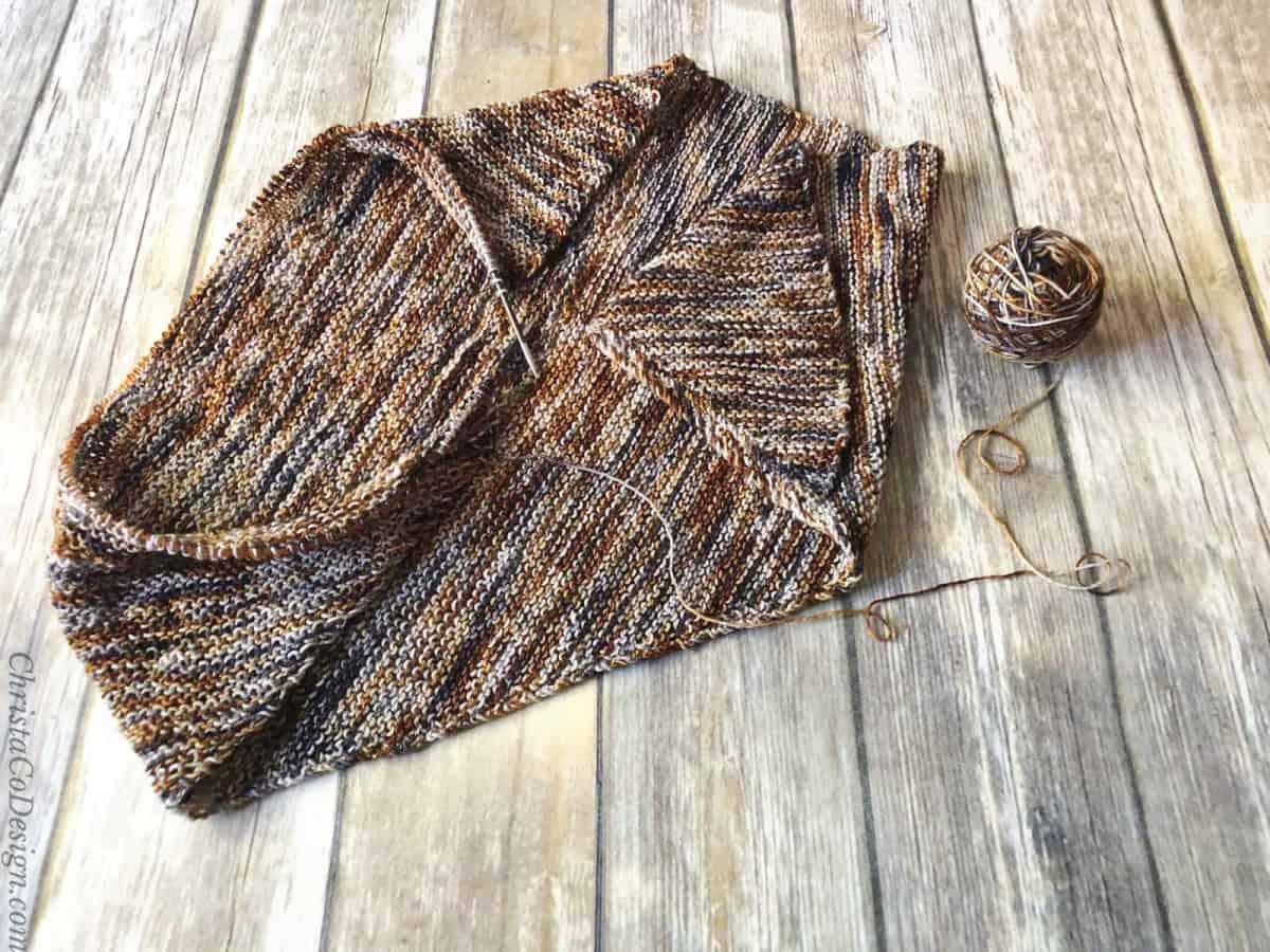 Progress of easy scarf knitting pattern for beginners on knitting needles.
