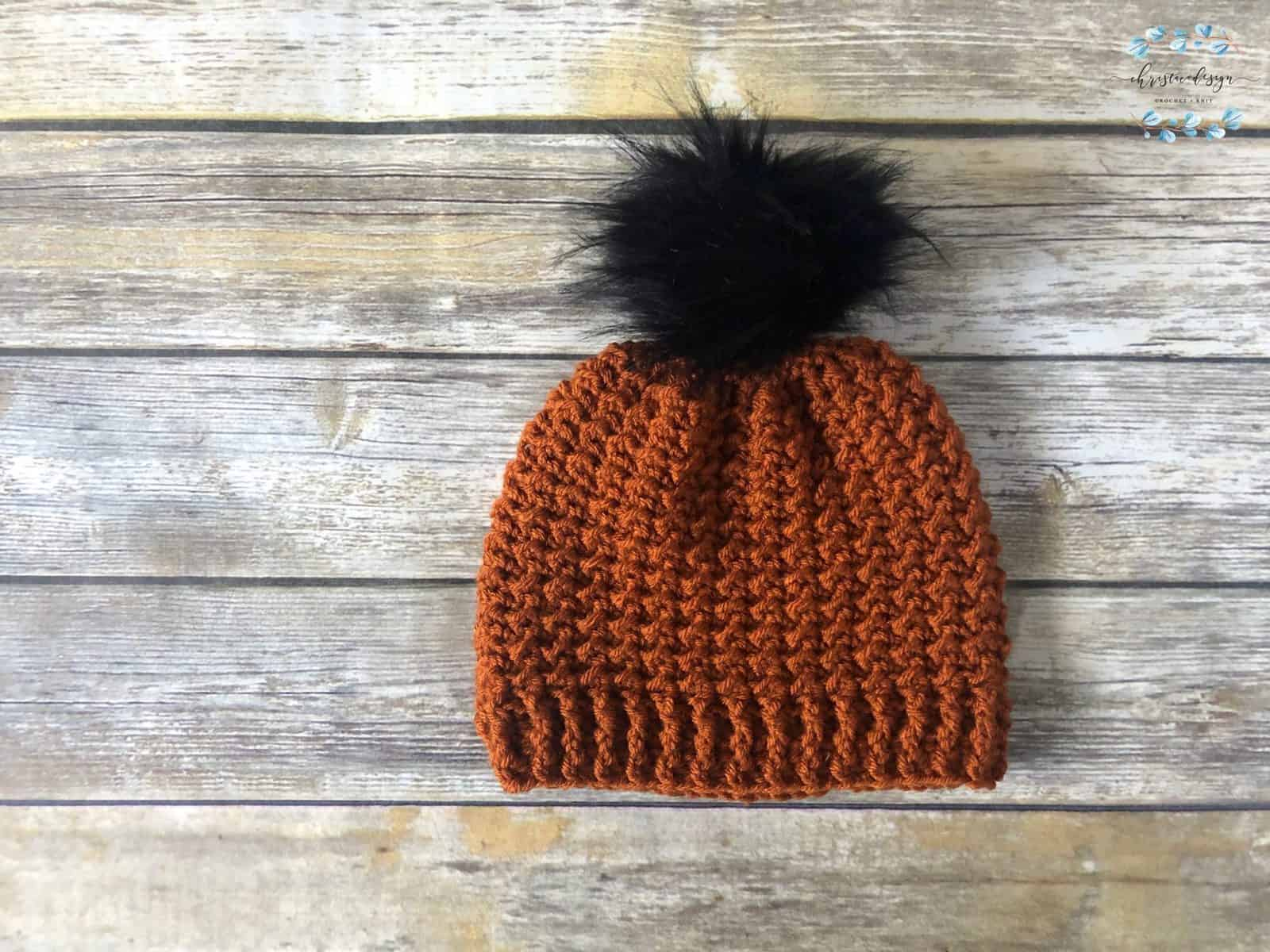 picture of one skein textured rust colored hat