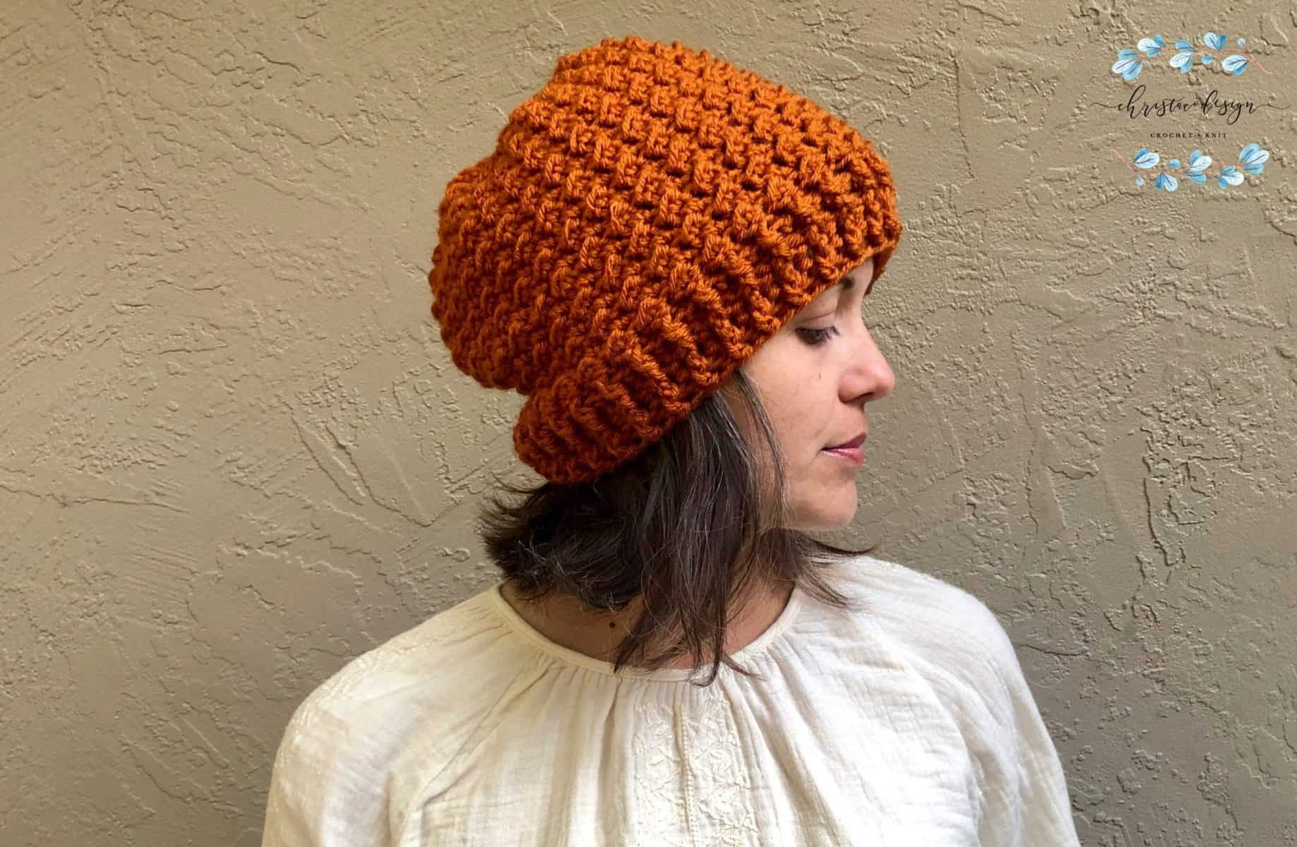 picture of woman in crochet textured hat rust colored