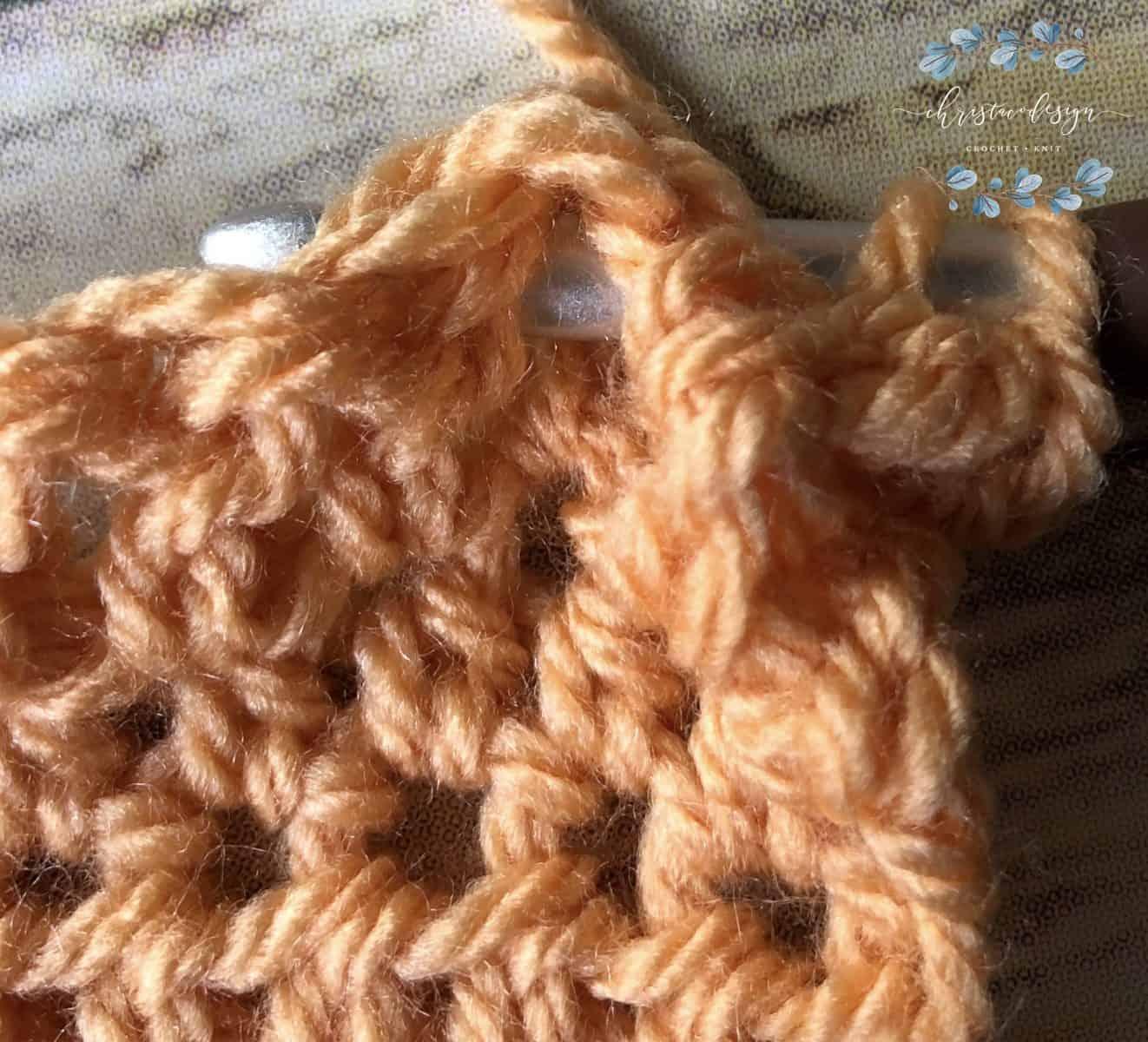 picture of orange yarn crochet tutorial for ribbing step 2