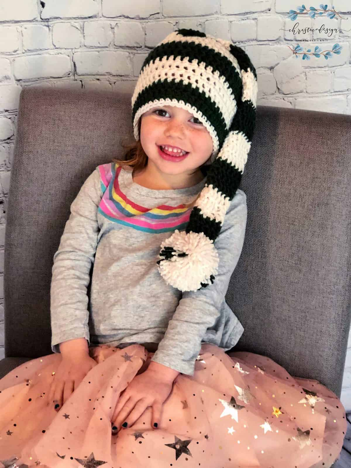 picture of girls wearing long stocking hat green and white striped
