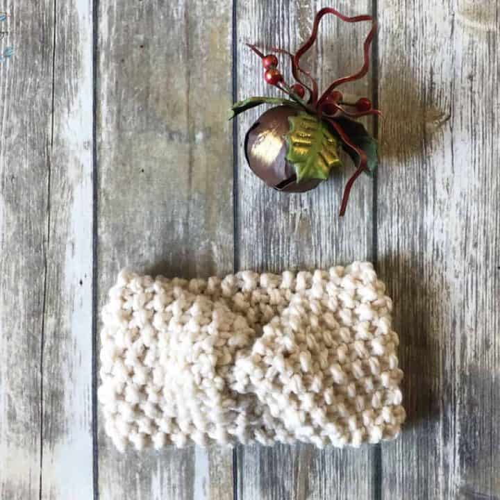 picture of easy knit ear warmer with Christmas bell