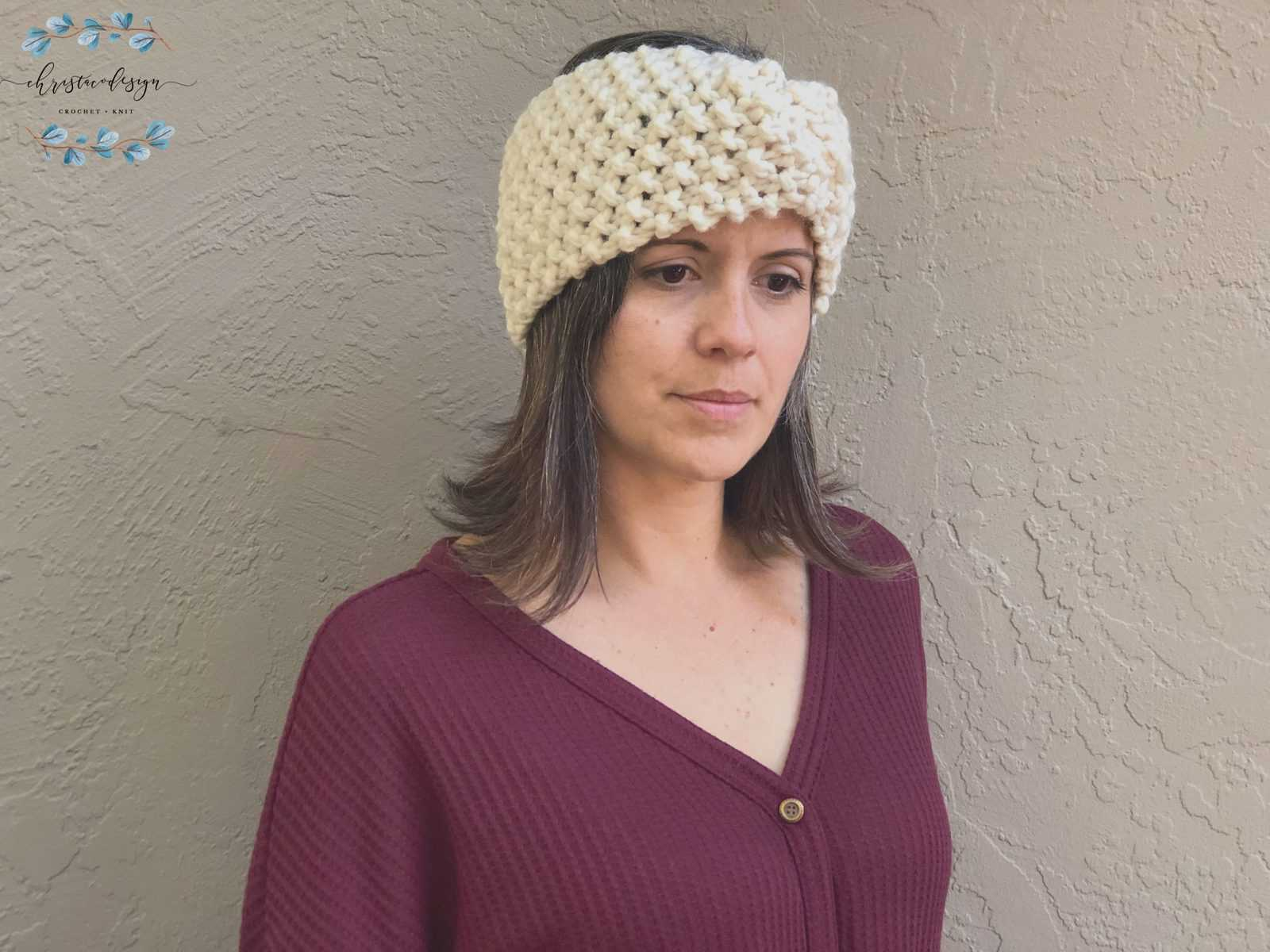 picture of woman in red wearing cream chunky knit ear warmer