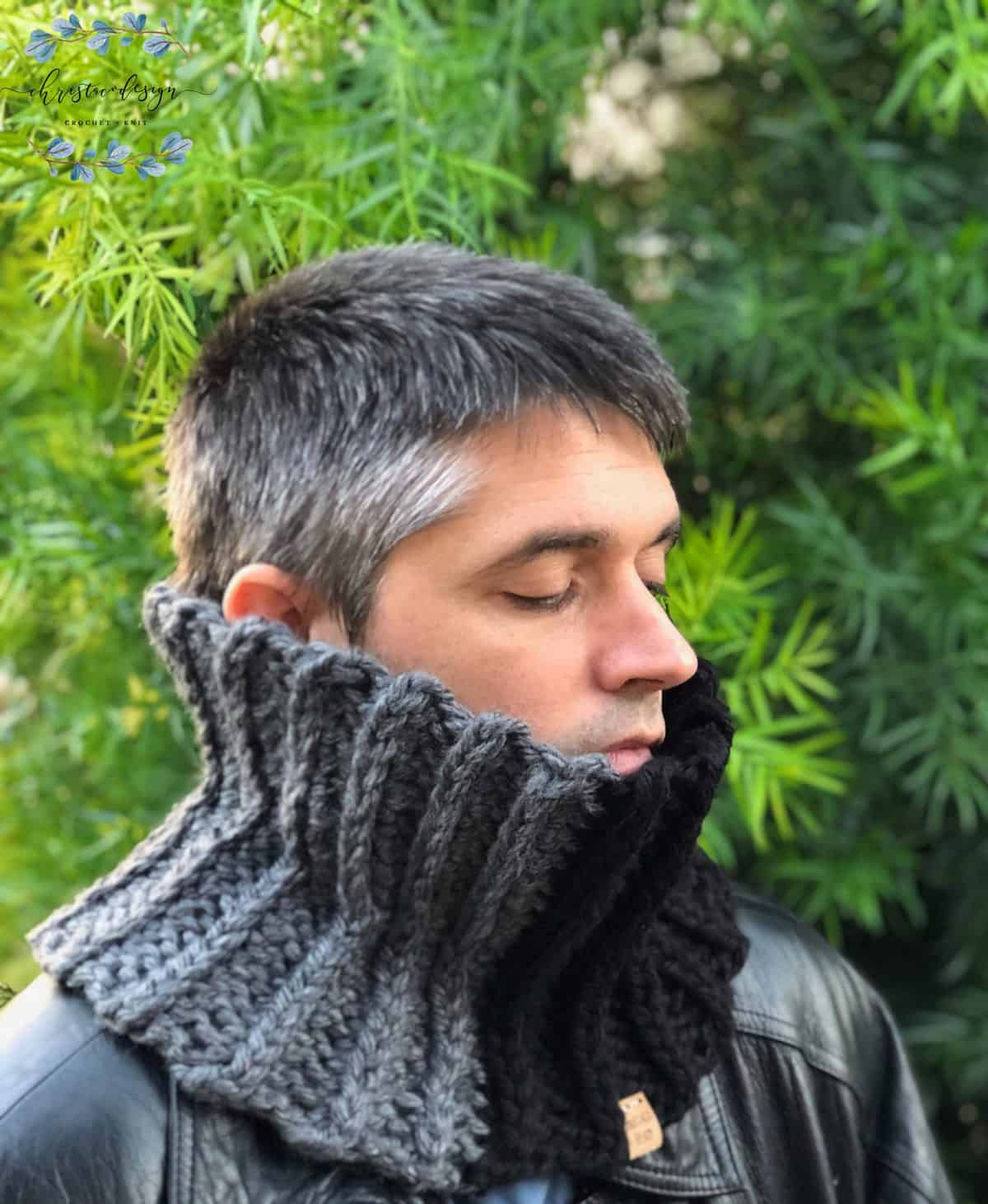 picture of man in dark grey and black chunky ribbed men's crochet cowl