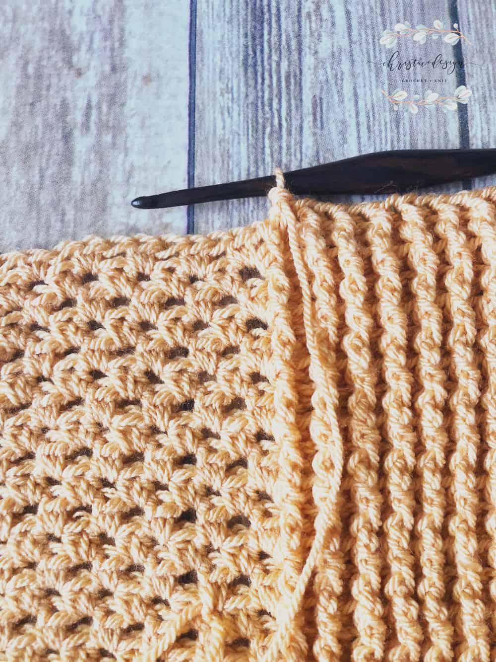 picture of crochet throw blanket in orange border stitches