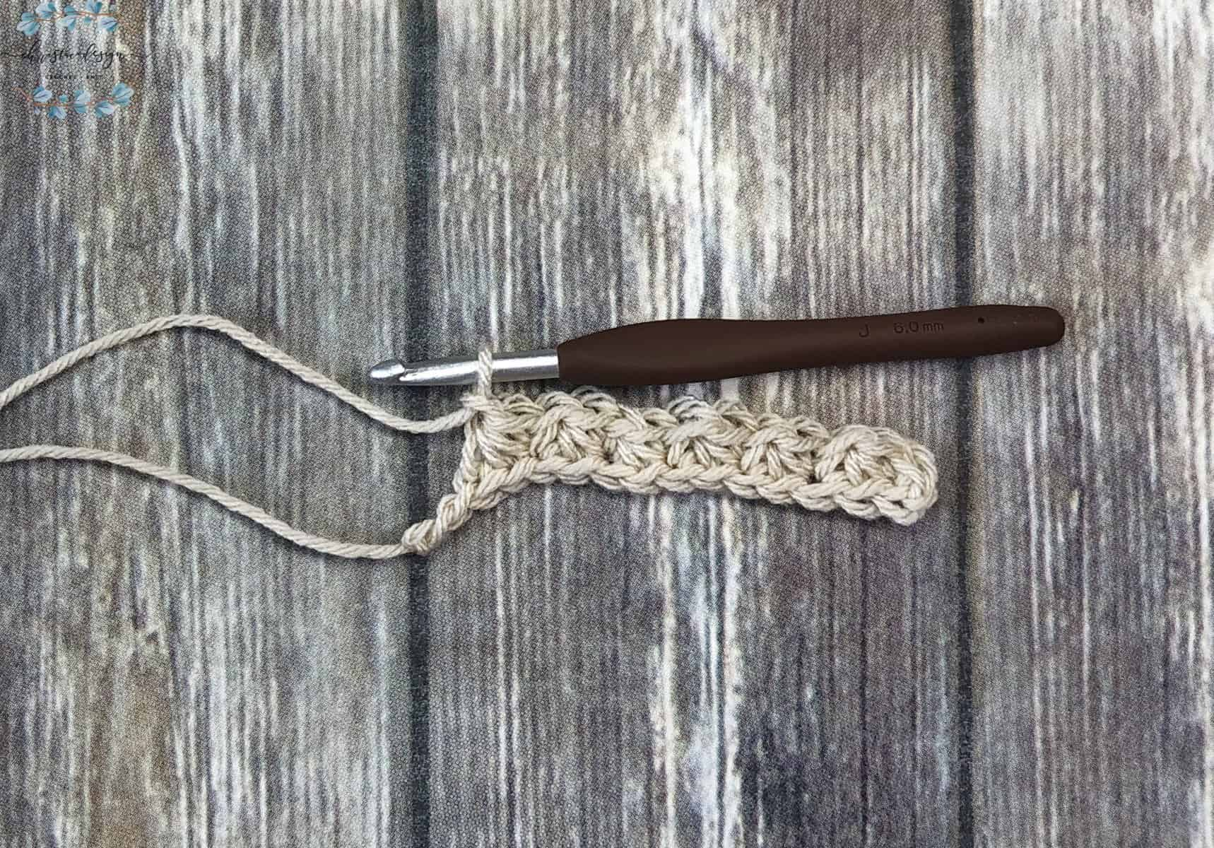 picture of trinity stitches across the row in beige yarn