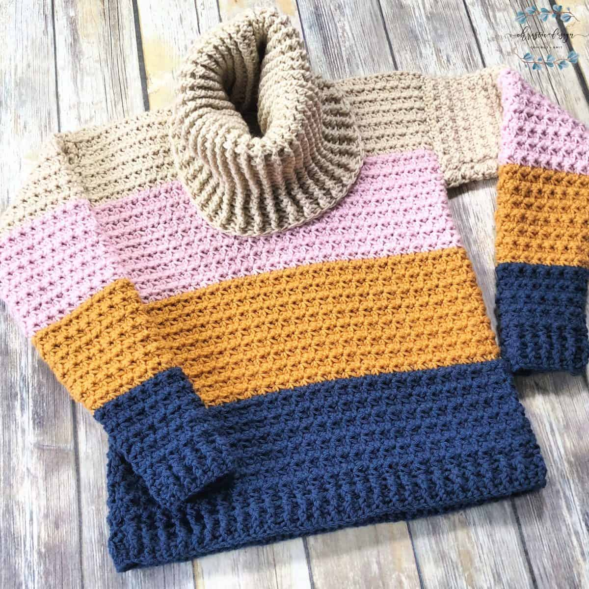 picture of blue, gold, pink and beige crochet sweater in trinity stitch