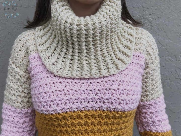 picture of woman in sun set colored Cowl neck sweater
