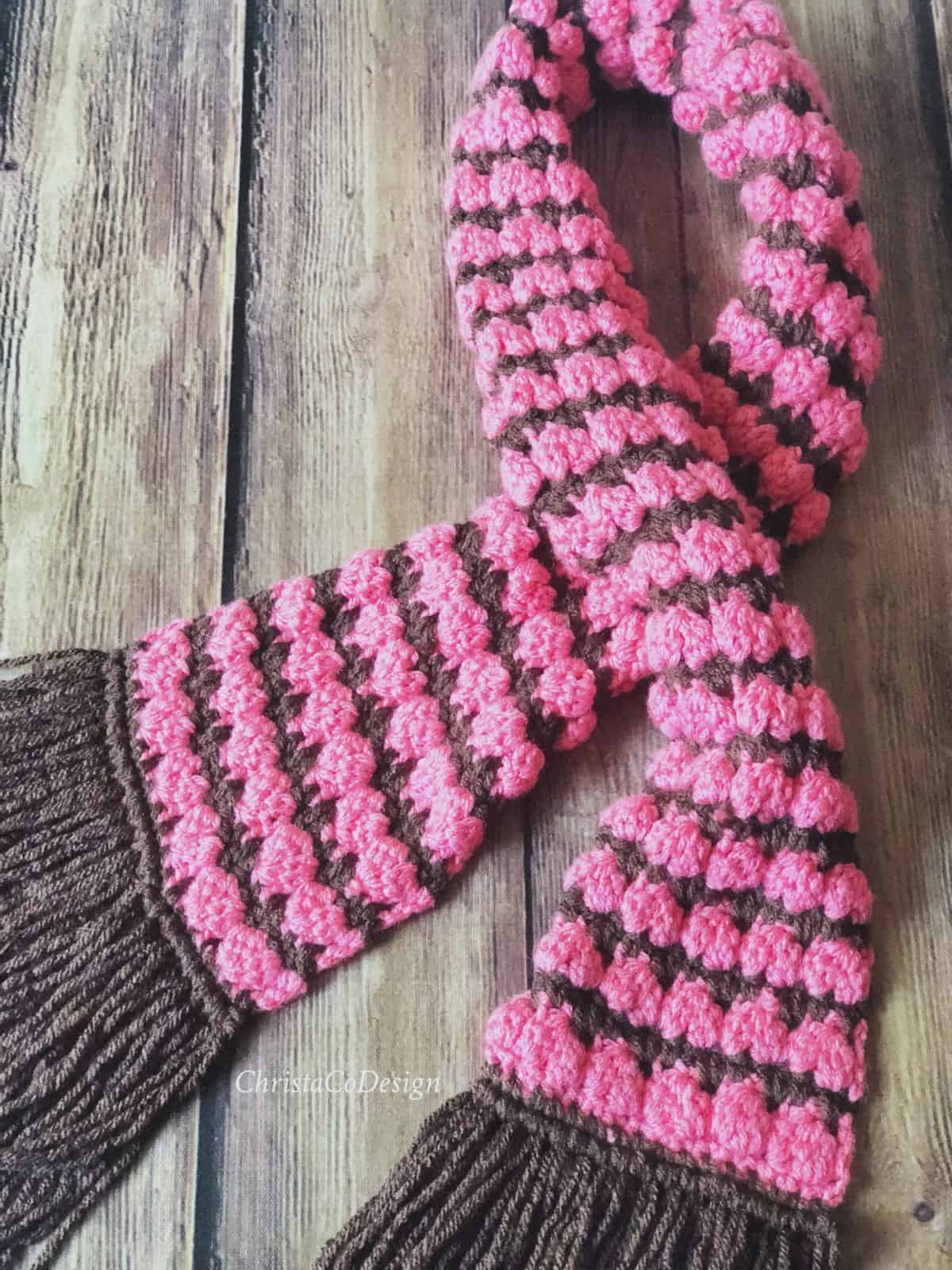 picture of pink and brown crochet scarf with fringe