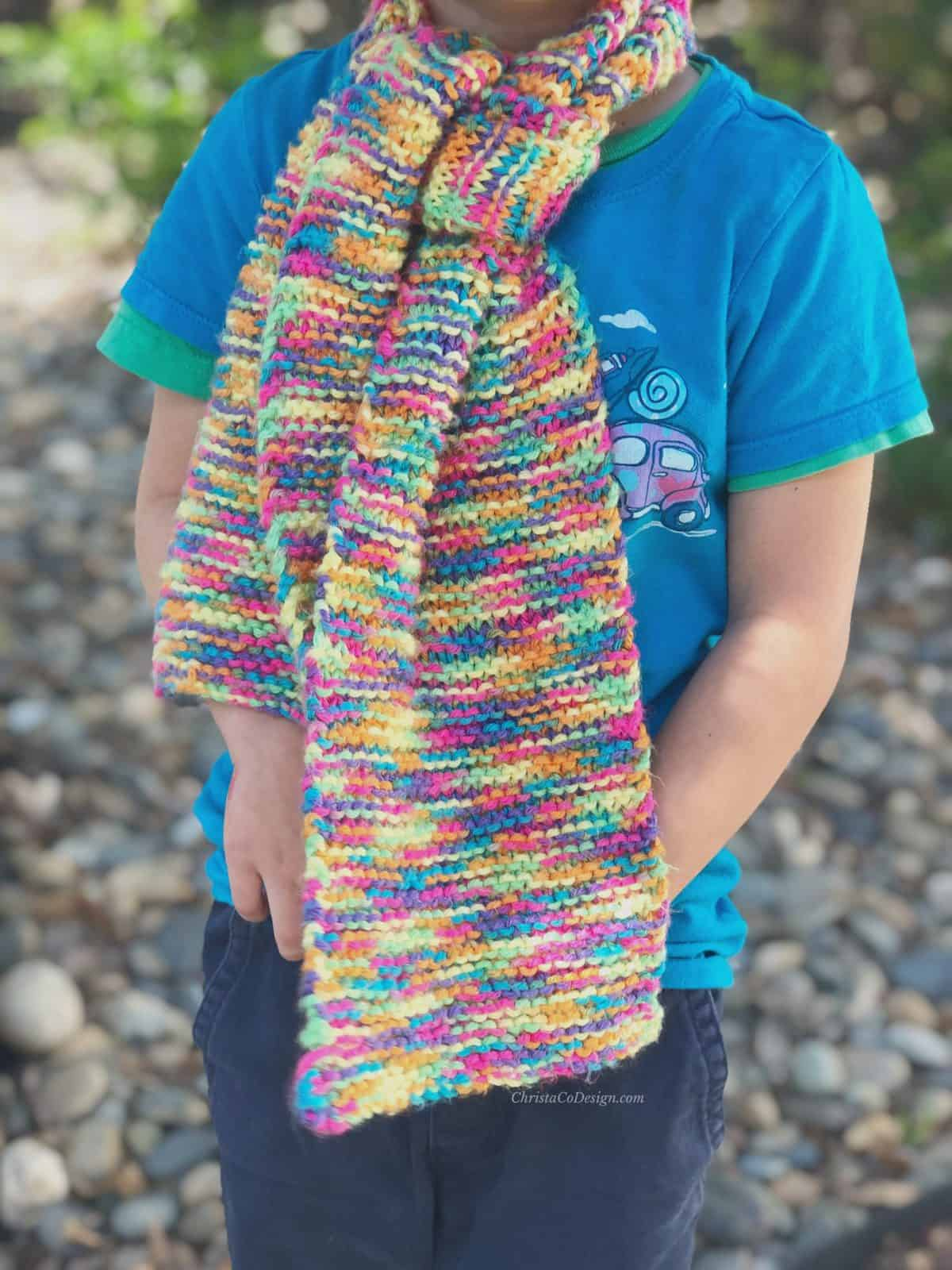picture of scarf knit colorful and modeled on boy