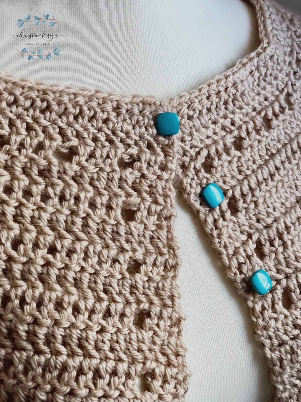 picture of teal buttoned crochet beige cardigan