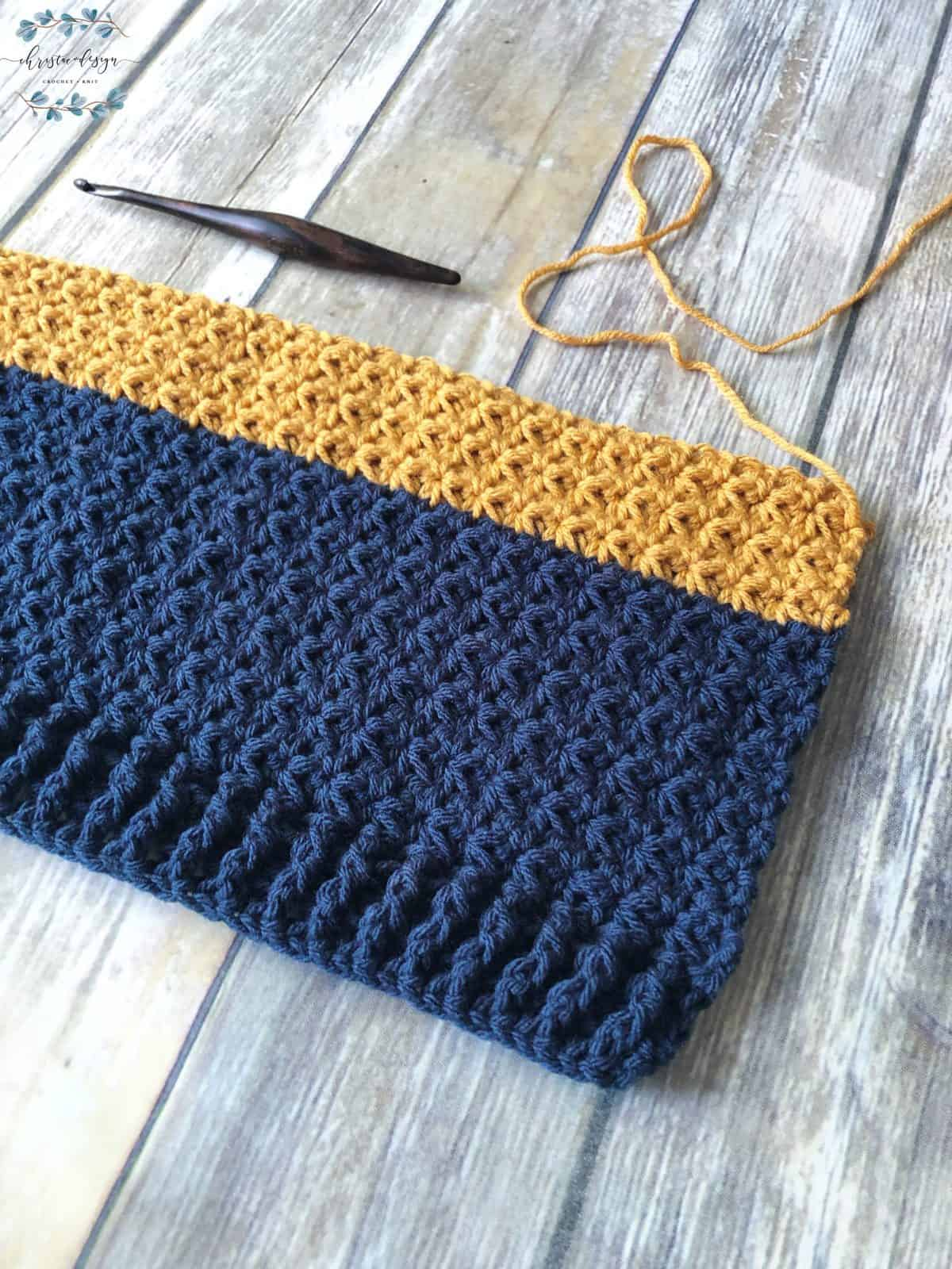 picture of crochet sweater in progress blue and gold