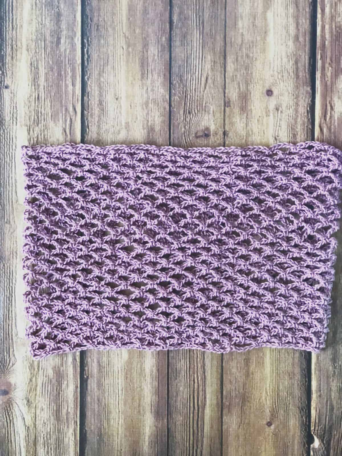 picture of archwork crochet cowl laid flat to show mesh