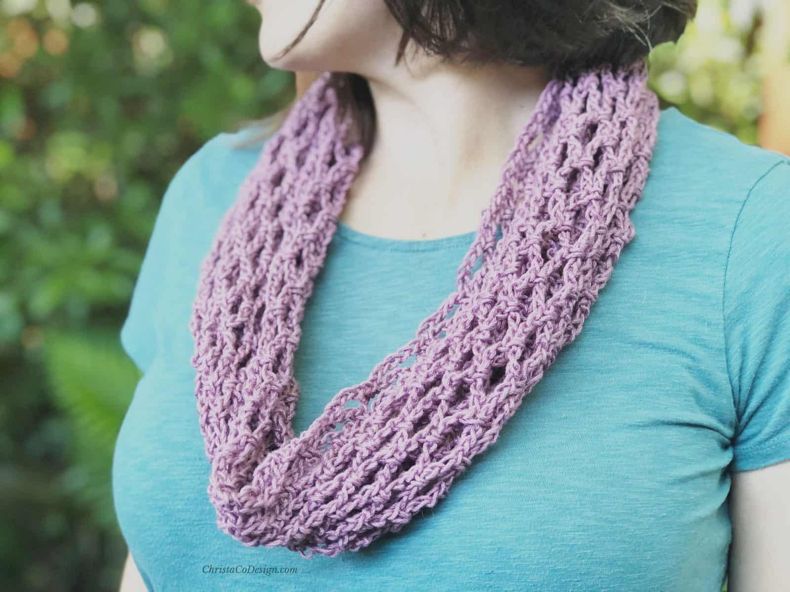 picture of woman wearing purple mesh crochet cowl