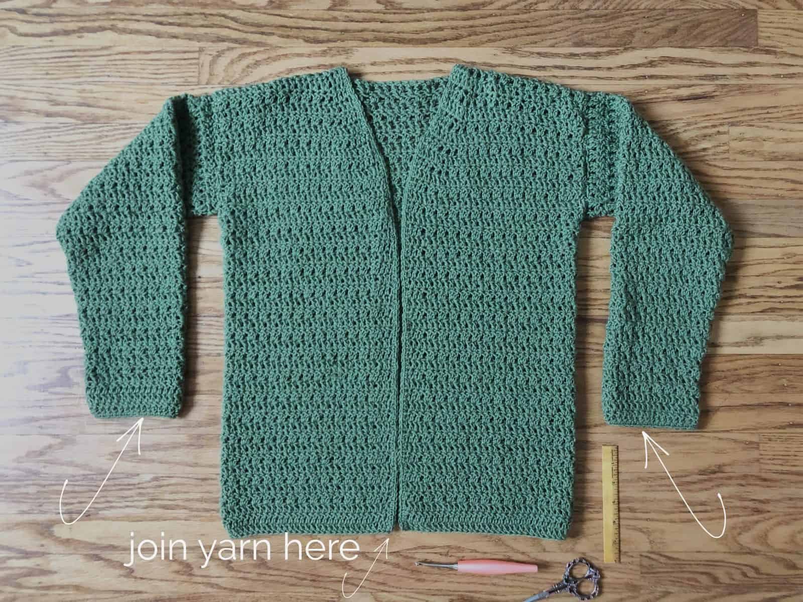 Finished crochet cardigan with text on where to add lapel.