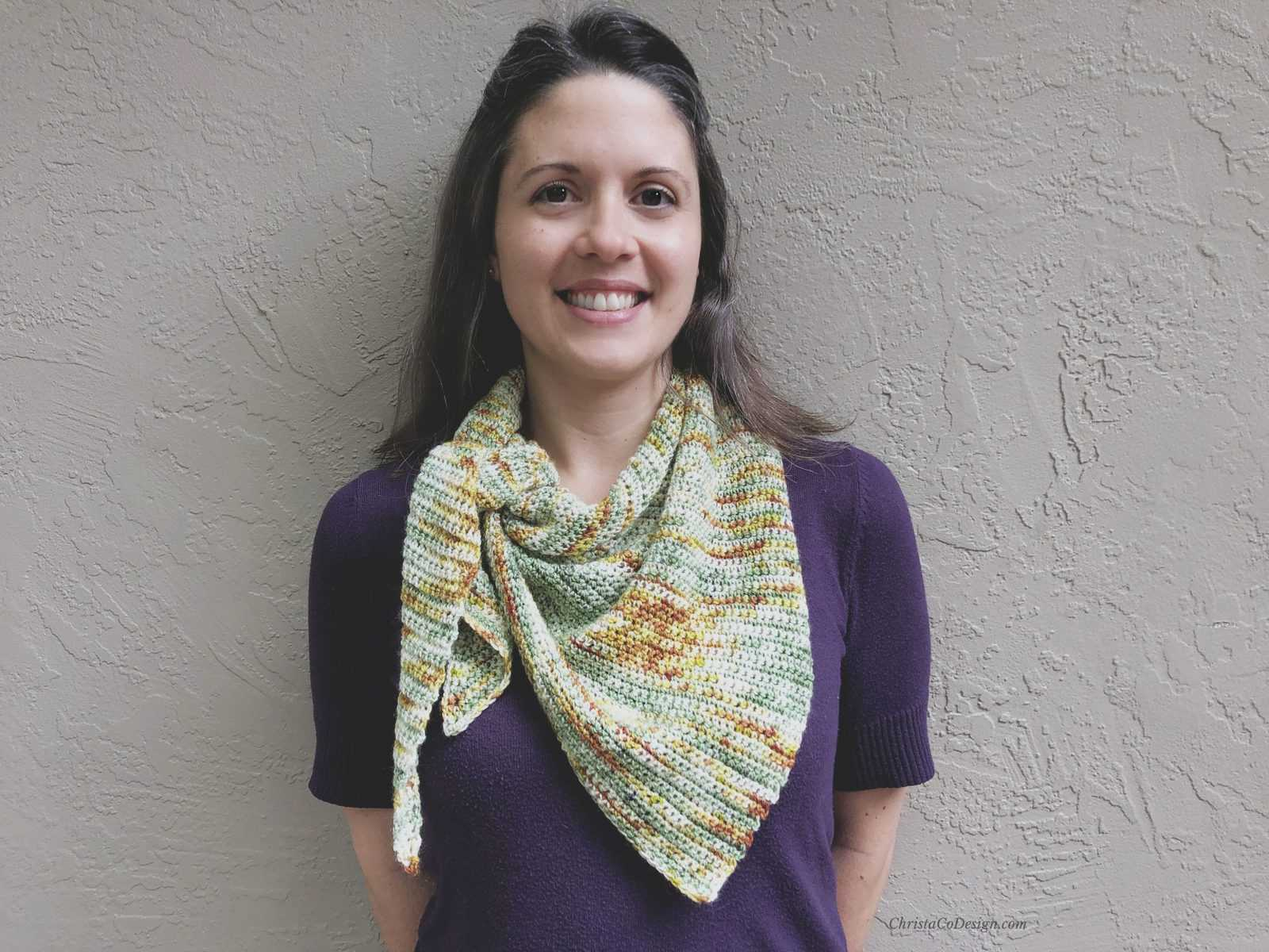 Picture of woman smiling in triangle scarf
